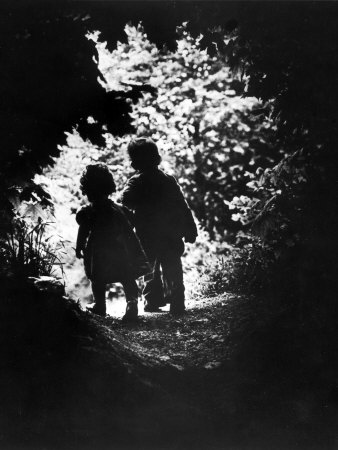 smith-w-eugene-children-of-photographer-with-eugene-smith-walking-hand-in-hand-in-woods-behind-his-home